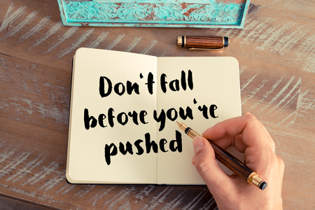 pushed: Handwritten quote Dont fall before youre pushed as inspirational concept image