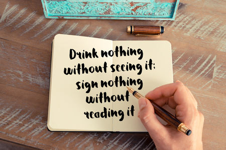 seeing: Handwritten quote Drink nothing with out seeing it; sign nothing without reading it as inspirational concept image