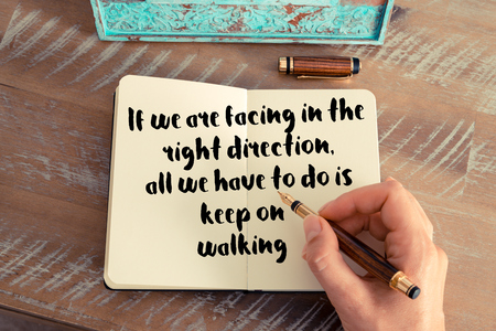 facing right: Handwritten quote If we are facing in the right direction, all we have to do is keep on walking as inspirational concept image