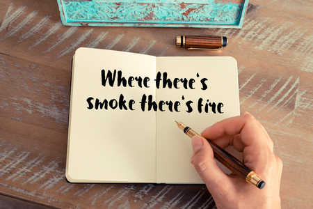 where: Handwritten quote Where theres smoke theres fire as inspirational concept image