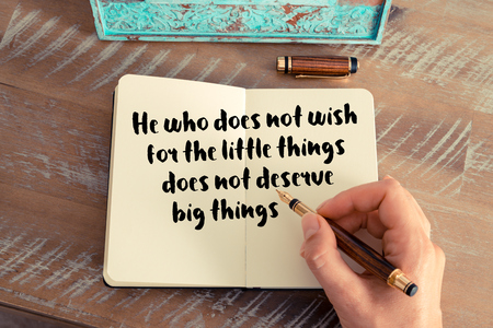 he: Handwritten quote He who does not wish for the little things does not deserve big things as inspirational concept image Stock Photo