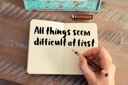 to seem: Handwritten quote All things seem difficult at first as inspirational concept image