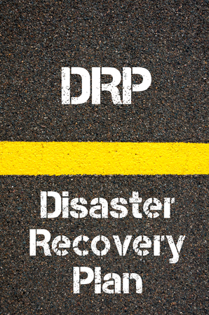 drp: Concept image of Business Acronym DRP Disaster Recovery Plan written over road marking yellow paint line