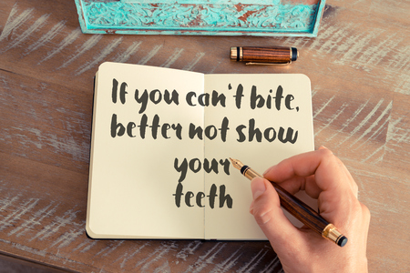 cant: Handwritten quote If you cant bite, better not show your teeth