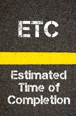 estimated: Concept image of Business Acronym ETC Estimated Time of Completion written over road marking yellow paint line Stock Photo