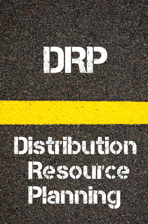drp: Concept image of Business Acronym DRP Distribution Resource Planning written over road marking yellow paint line Stock Photo