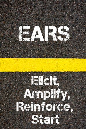 elicit: Concept image of Business Acronym EARS Elicit, Amplify, Reinforce, And Start written over road marking yellow paint line