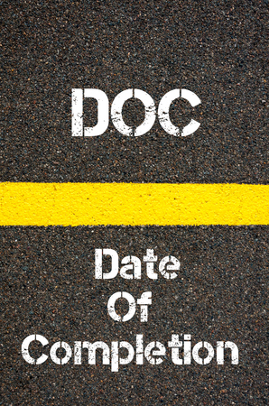 docs: Concept image of Business Acronym DOC Date Of Completion written over road marking yellow paint line