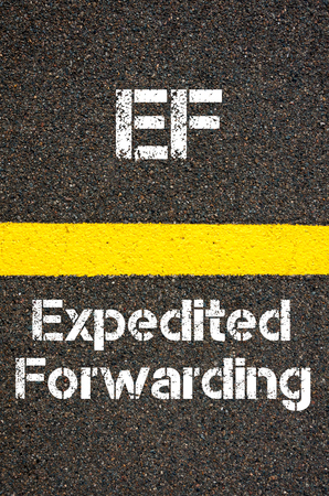 forwarding: Concept image of Business Acronym EF Expedited Forwarding written over road marking yellow paint line