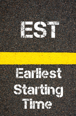 est: Concept image of Business Acronym EST Earliest Starting Time written over road marking yellow paint line