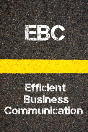 written communication: Concept image of Business Acronym EBC Efficient Business Communication written over road marking yellow paint line Stock Photo