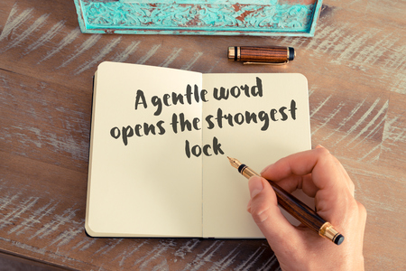strongest: Handwritten quote A gentle word opens the strongest lock Stock Photo