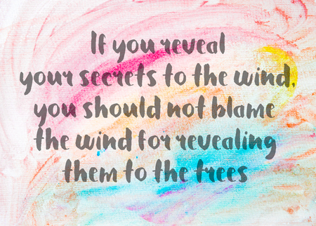 them: If you reveal your secrets to the wind, you should not blame the wind for revealing them to the trees. Inspirational quote over abstract water color textured background Stock Photo