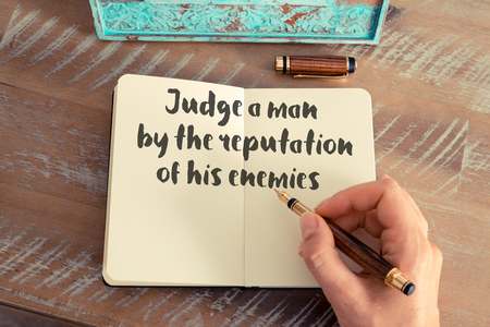 enemies: Handwritten quote Judge a man by the reputation of his enemies