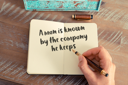 he: Handwritten quote A man is known by the company he keeps