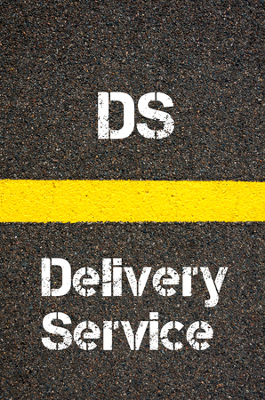 financial guidance: Concept image of Business Acronym DS Delivery Service written over road marking yellow paint line
