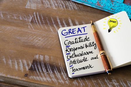Conceptual Business Acronym GREAT Gratitude, Responsibility, Enthusiasm, Attitude, and Teamwork. Retro effect and toned image of a fountain pen on a notebook Stock Photo