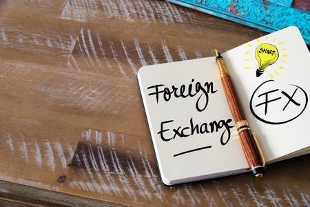 fx: Conceptual Business Acronym FX Foreign Exchange. Retro effect and toned image of a fountain pen on a notebook Stock Photo
