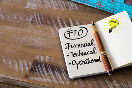 operational: Conceptual Business Acronym FTO Financial, Technical, Operational. Retro effect and toned image of a fountain pen on a notebook