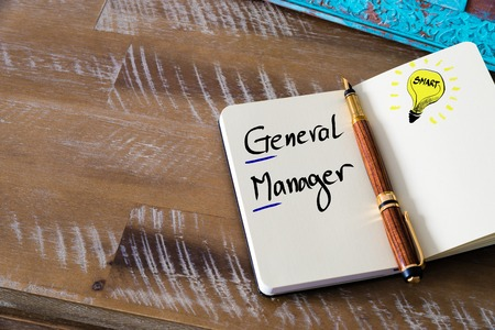 general knowledge: Conceptual Business Acronym GM as General Manager. Retro effect and toned image of a fountain pen on a notebook