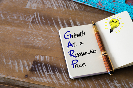 reasonable: Conceptual Business Acronym GARP Growth At a Reasonable Price. Retro effect and toned image of a fountain pen on a notebook