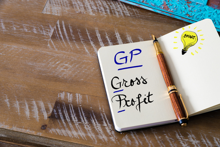gp: Conceptual Business Acronym GP Gross Profit. Retro effect and toned image of a fountain pen on a notebook Stock Photo