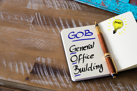 general knowledge: Conceptual Business Acronym GOB General Office Building. Retro effect and toned image of a fountain pen on a notebook