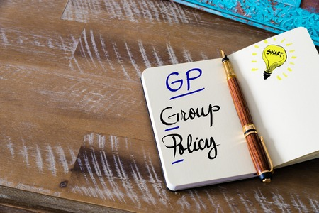gp: Conceptual Business Acronym GP Group Policy. Retro effect and toned image of a fountain pen on a notebook Stock Photo