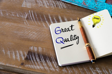 Conceptual Business Acronym GQ Great Quality. Retro effect and toned image of a fountain pen on a notebook Stock Photo