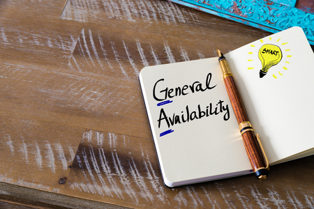 ga: Conceptual Business Acronym GA as General Availability. Retro effect and toned image of a fountain pen on a notebook