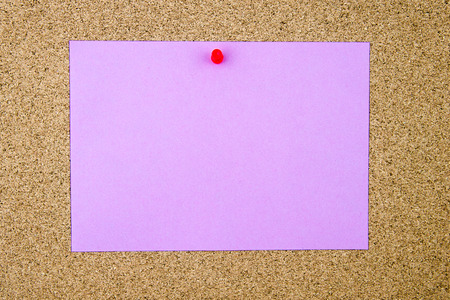cork sheet: Blank violet paper note pinned on cork board with red thumbtack, copy space available Stock Photo