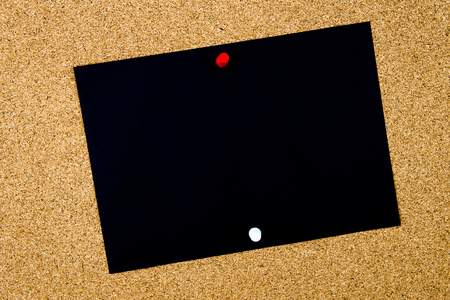 cork sheet: Blank black paper note pinned on cork board with white and red thumbtacks, copy space available