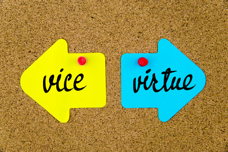 virtue: Message Vice versus Virtue on yellow and blue paper notes as opposite arrows pinned on cork board with thumbtacks. Choice conceptual image