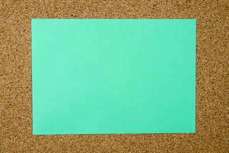 cork sheet: Blank turquoise paper note over cork board background, copy space available