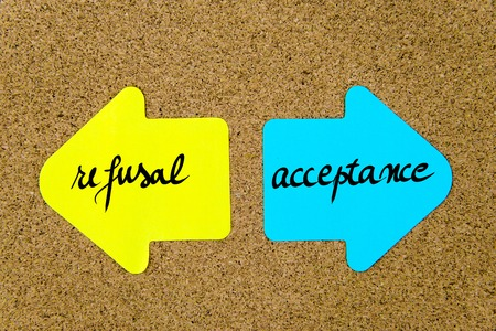 refusal: Message  Refusal versus Acceptance on yellow and blue paper notes as opposite arrows pinned on cork board with thumbtacks. Choice conceptual image Stock Photo
