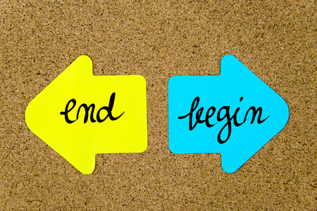 yellow thumbtacks: Message End versus Begin on yellow and blue paper notes as opposite arrows pinned on cork board with thumbtacks. Choice conceptual image