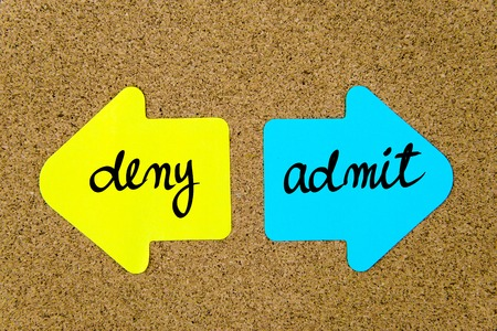 deny: Message Deny versus Admit on yellow and blue paper notes as opposite arrows pinned on cork board with thumbtacks. Choice conceptual image