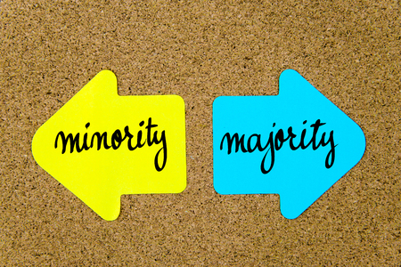 majority: Message Minority versus Majority on yellow and blue paper notes as opposite arrows pinned on cork board with thumbtacks. Choice conceptual image