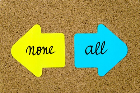 none: Message None versus All on yellow and blue paper notes as opposite arrows pinned on cork board with thumbtacks. Choice conceptual image Stock Photo