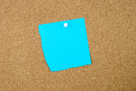 thumbtack: Blank turquoise paper note pinned on cork board with white thumbtack, copy space available Stock Photo
