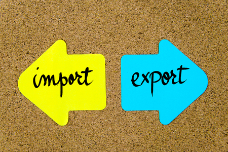 yellow thumbtacks: Message Import versus Export on yellow and blue paper notes as opposite arrows pinned on cork board with thumbtacks. Choice conceptual image
