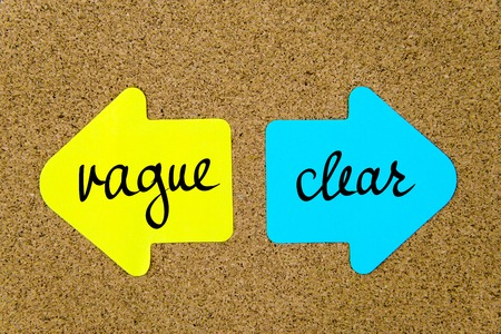 vague: Message Vague versus Clear on yellow and blue paper notes as opposite arrows pinned on cork board with thumbtacks. Choice conceptual image Stock Photo