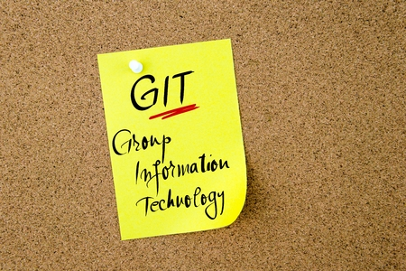 git: Business Acronym GIT Group Information Technology written on  yellow paper note pinned on cork board with white thumbtack, copy space available
