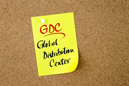 distribution board: Business Acronym GDC Global Distribution Center written on  yellow paper note pinned on cork board with white thumbtack, copy space available Stock Photo