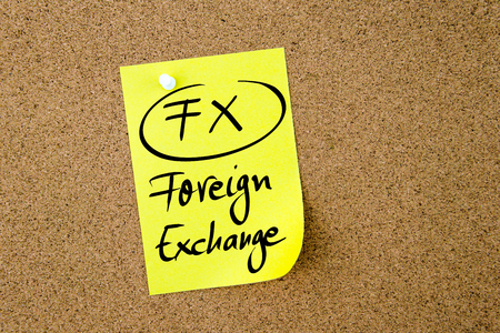 fx: Business Acronym FX Foreign Exchange written on  yellow paper note pinned on cork board with white thumbtack, copy space available Stock Photo
