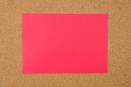 cork sheet: Blank red paper note over cork board background, copy space available