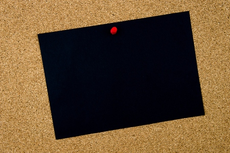 thumbtack: Blank black paper note pinned on cork board with red thumbtack, copy space available