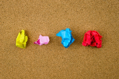 group of colourful ball: Colorful crumpled papers over cork background
