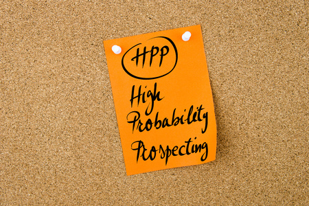 prospecting: Business Acronym HPP High Probability Prospecting written on  orange paper note pinned on cork board with white thumbtack, copy space available