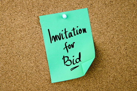 bid: Invitation For Bid written on green paper note pinned on cork board with white thumbtacks, copy space available